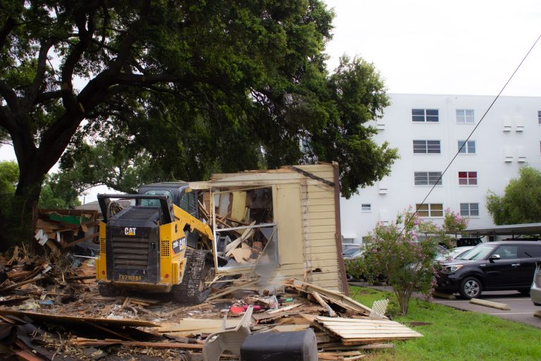 skid steer demolishing pinellas house