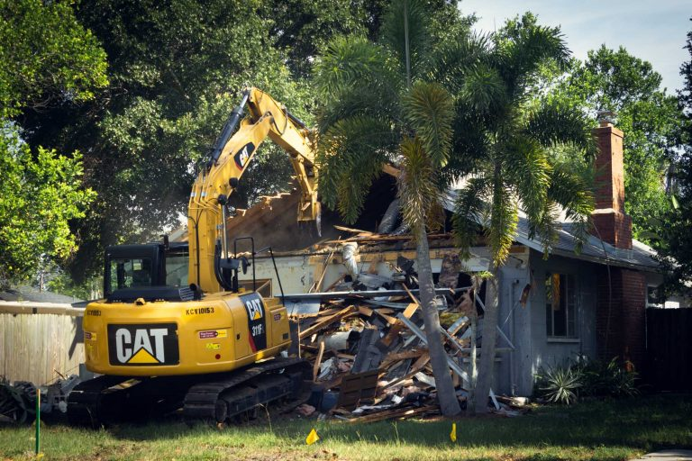 excavator demolishing a house residential demolition contractor