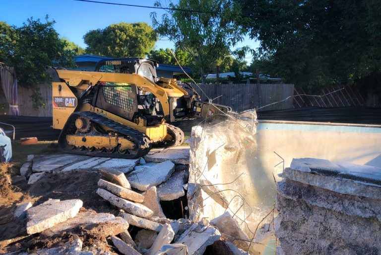 pool demolition with a bobcat