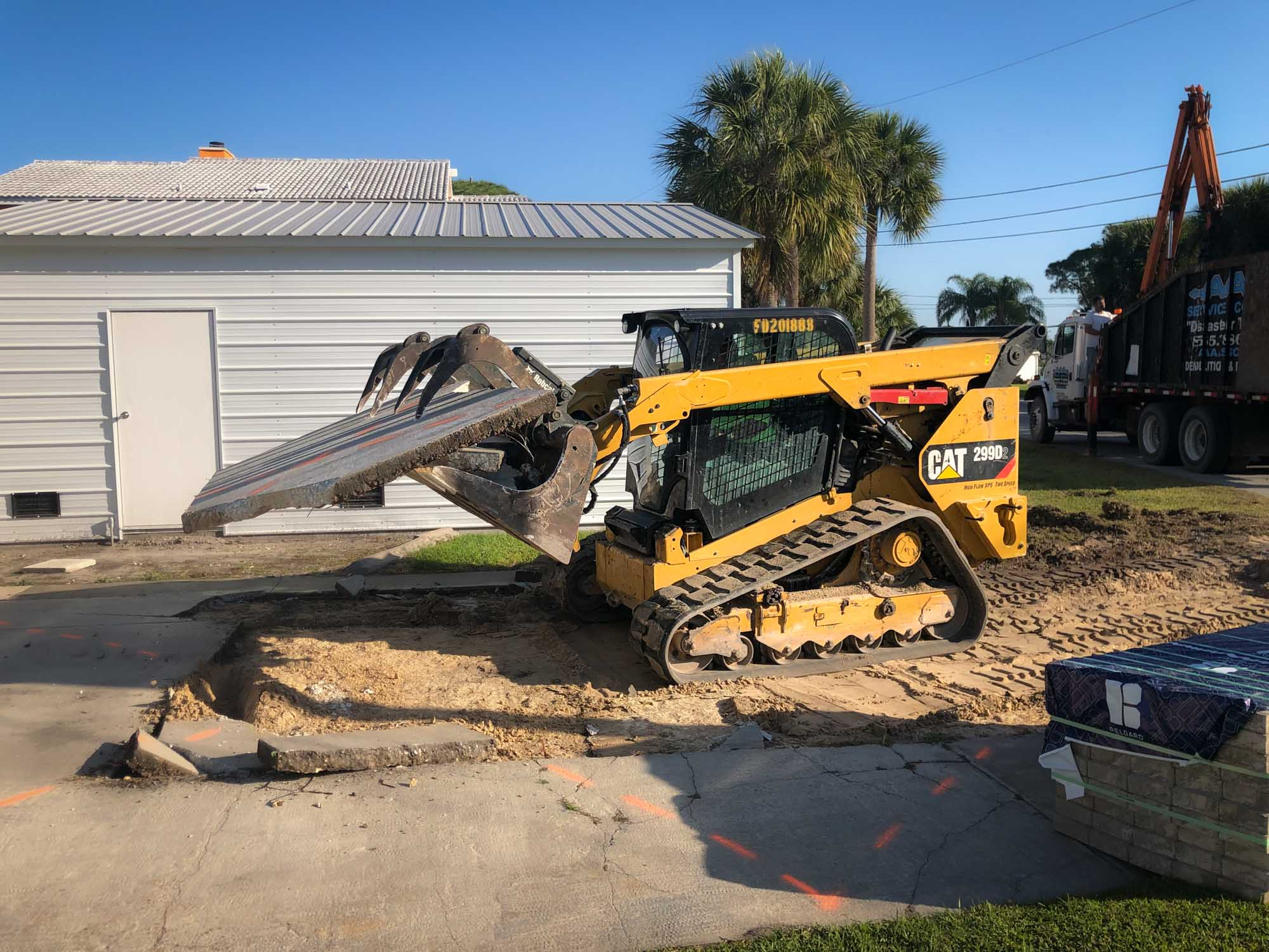skid steer removing concrete residential home